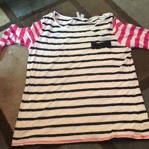 Black and white striped shirt with pink sleeve